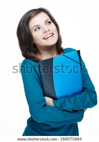 Attractive young woman in a blue shirt. Holding folder and looking to the left. Isolated on white background - stock photo