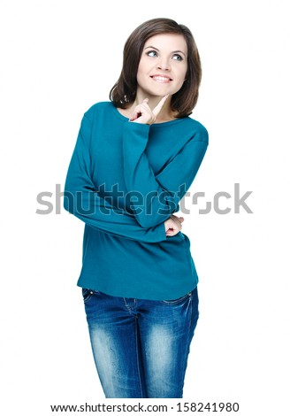 Attractive young woman in a blue shirt. Holding her finger on her chin. Isolated on white background - stock photo