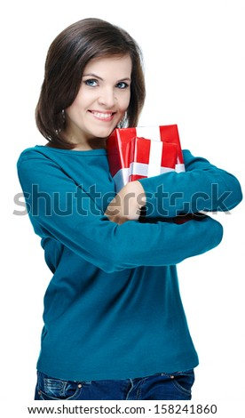 Attractive young woman in a blue shirt. Holding red gift box. Isolated on white background