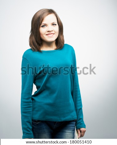 Attractive young woman in a blue shirt. On a gray background - stock photo