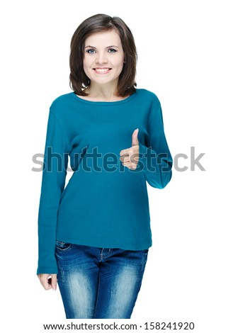 Attractive young woman in a blue shirt. Showing thumbs up. Isolated on white background