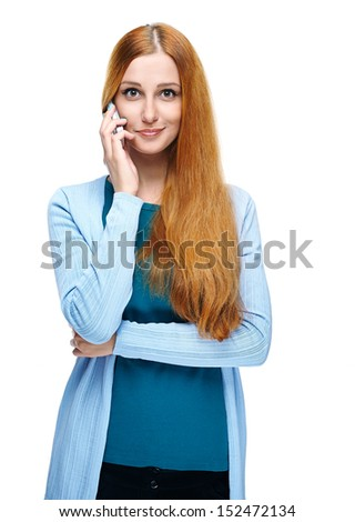 Attractive young woman in a blue shirt. Talking on a mobile phone. Isolated on white background - stock photo