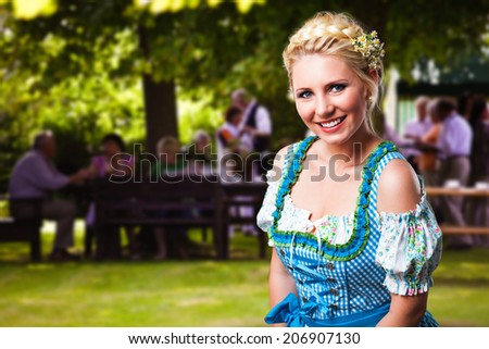 attractive young woman in a dirndl - stock photo
