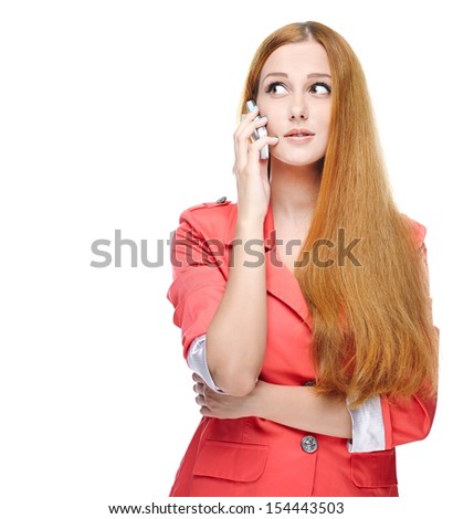 Attractive young woman in a pink jacket. Talking on a mobile phone. Looking to the right. Isolated on white background