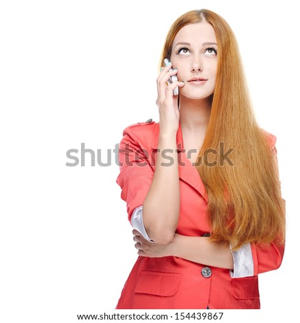 Attractive young woman in a pink jacket. Talking on a mobile phone. Looking up. Isolated on white background