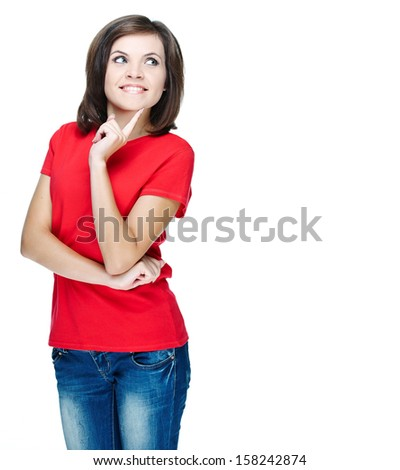 Attractive young woman in a red shirt. Holding her finger on her chin. Isolated on white background
