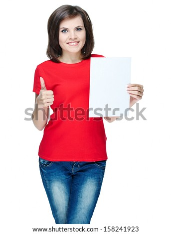 Attractive young woman in a red shirt. Holds a poster and showing thumbs up. Isolated on white background