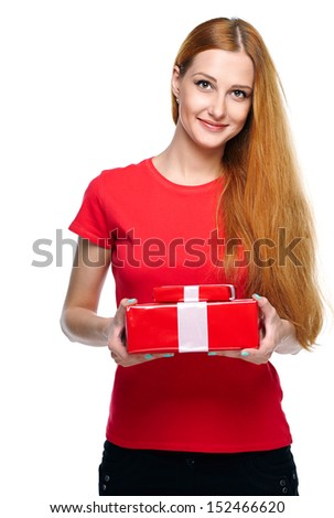 Attractive young woman in a red shirt. Holds a red gift box. Isolated on white background - stock photo