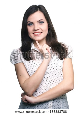 Attractive young woman in a white blouse. Woman holds her finger on her chin. Isolated on white background