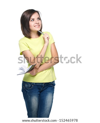 Attractive young woman in a yellow shirt. Keep a notepad and pen. Isolated on white background