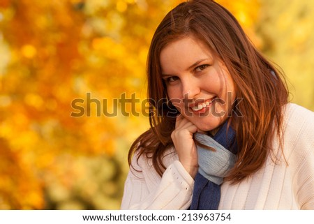 Attractive young woman in an autumn setting