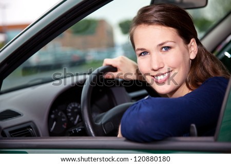 Attractive young woman in car - stock photo