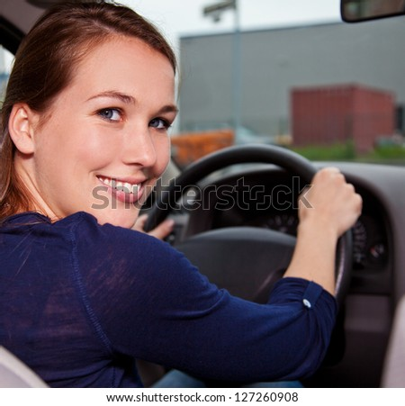 Attractive young woman in car. - stock photo