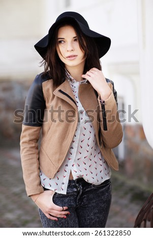 Attractive young woman in hat outdoor - stock photo