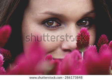 Attractive Young Woman In Pink Clover Field Close Up Portrait - stock photo