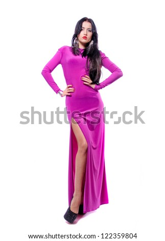 Attractive young woman in purple dress isolated on white background - stock photo