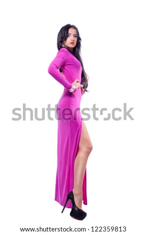 Attractive young woman in purple dress isolated on white background