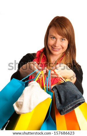 Attractive young woman in shopping isolated over white