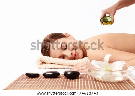 Attractive young woman in spa salon - stock photo