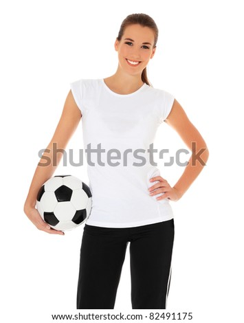 Attractive young woman in sports wear holding soccer ball. All on white background. - stock photo