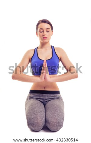 Attractive young woman in sportswear is doing yoga, isolated on white background