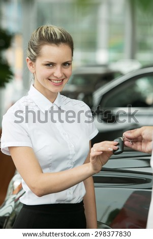 attractive young woman in the car with the keys - stock photo