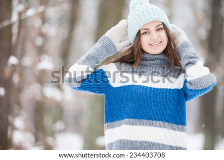 Attractive young woman in winter park - stock photo