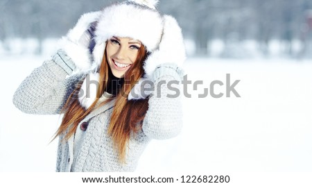 Attractive young woman in wintertime outdoor - stock photo
