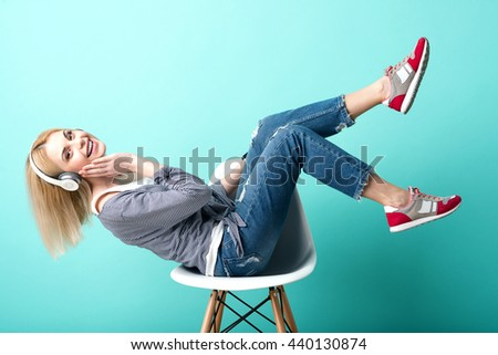 Attractive young woman is enjoying melody - stock photo