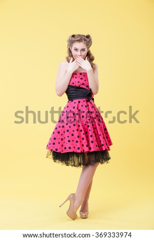 Attractive young woman is expressing her surprise - stock photo