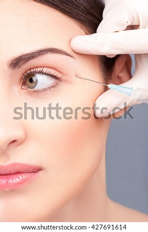 Attractive young woman is getting botox injection