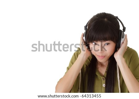 Attractive young woman listening music by headphone with copyspace on white. - stock photo