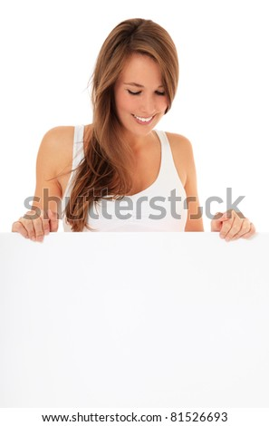 Attractive young woman looking down blank white sign. All on white background. - stock photo
