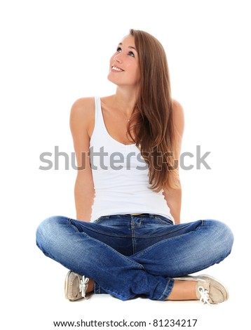 Attractive young woman looking up. All on white background. - stock photo
