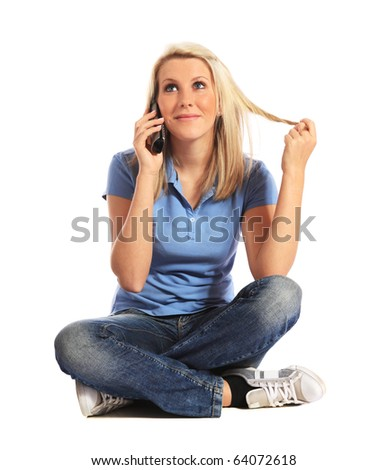 Attractive young woman making a phone call. All on white background.