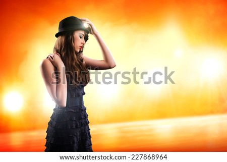 attractive young woman on a stage - stock photo
