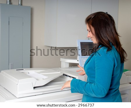 Attractive Young Woman Photocopying At The Office - stock photo