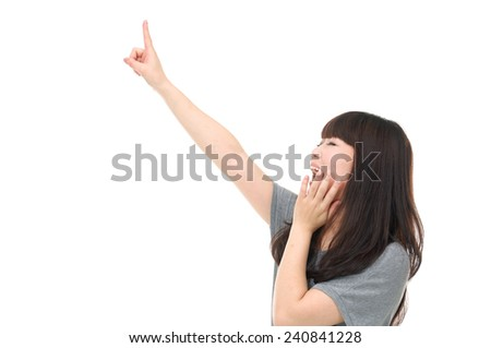 attractive young woman pointing her finger - stock photo