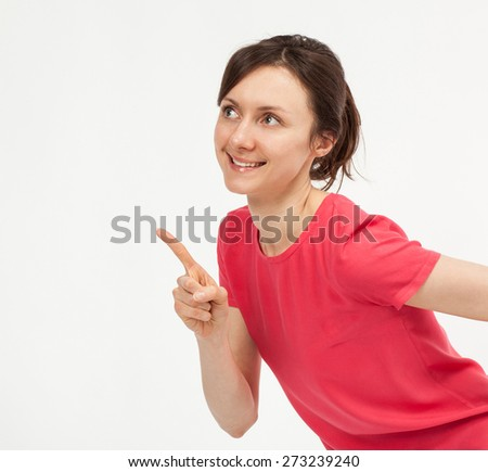 Attractive young woman pointing up, closeup studio shot - stock photo