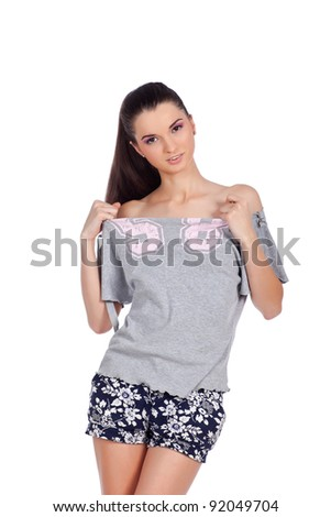 Attractive young woman posing in casual clothes. High resolution image taken in studio. Isolated on pure white background with copy space for your ad. - stock photo