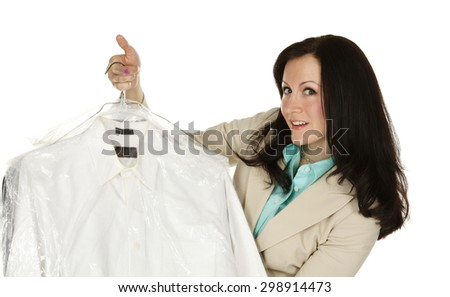 Attractive young woman presenting professionally laundered shirts.