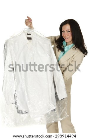 Attractive young woman presenting professionally laundered shirts. - stock photo