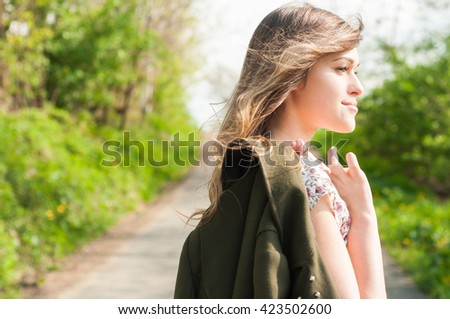 Attractive young woman relaxing and walking in the nature on summer sunny day - stock photo