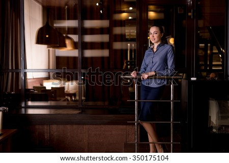 Attractive young woman resting in restaurant