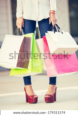 Attractive young woman shopping at the mall - stock photo