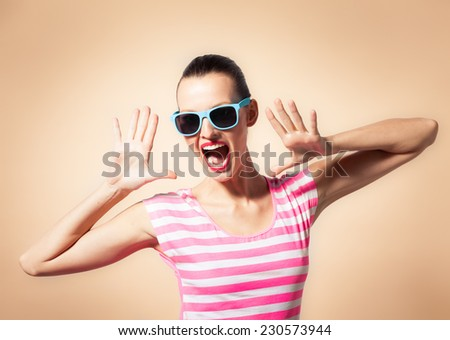 Attractive young woman shouting or yelling - stock photo