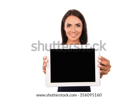 Attractive young woman showing a screen of tablet - stock photo