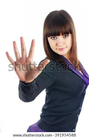 Attractive young woman showing stop gesture, Isolated over white background - stock photo