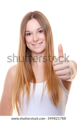 Attractive young woman showing thumbs up. All on white background. - stock photo
