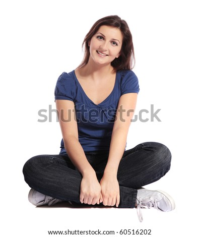 Attractive young woman sitting cross-legged. All isolated on white background. - stock photo